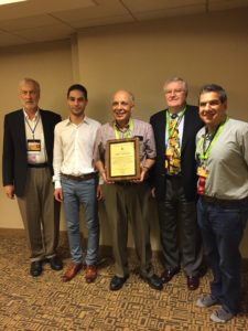 Gathering around the award for Y. T. , Frank, Aram, Levon, Bob and Armen