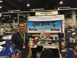 Armen Moloian in front of his booth at the American Numismatic Association exhibition in Anaheim.